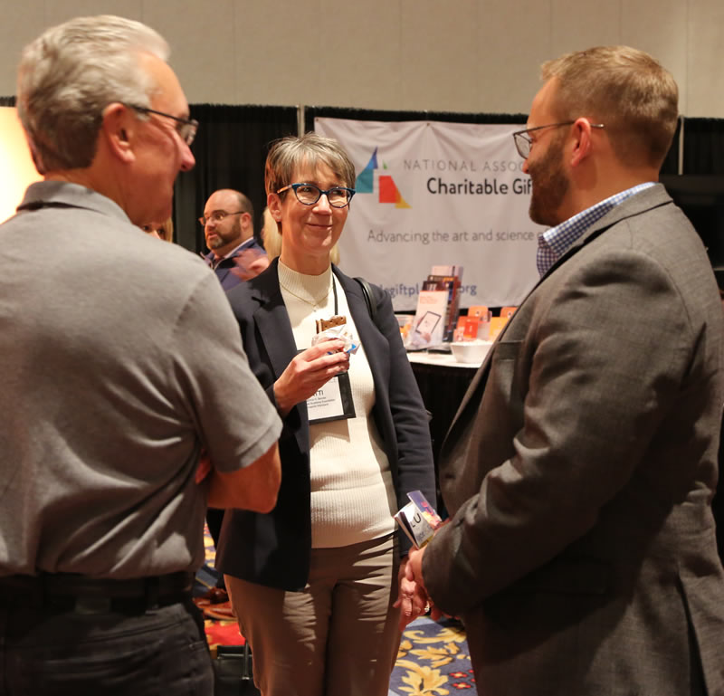 Larry and Nathan speak with a client at CGP 2018.