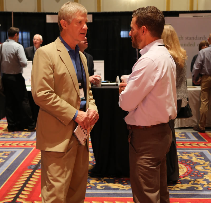 Jeremy Stelter speaks with a client at CGP 2018.
