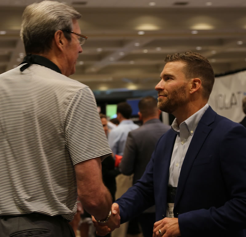 Jeremy Stelter visits with a colleague at the 2019 NCPP Conference.