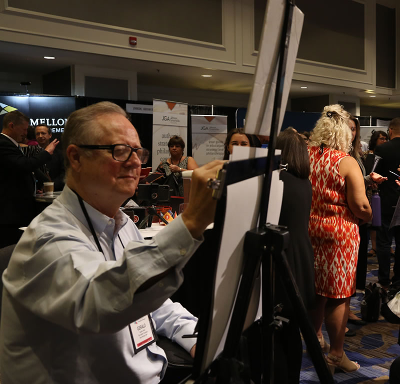 Caricature artist, Gerald Atkin, does his magic at the 2019 NCPP Conference.