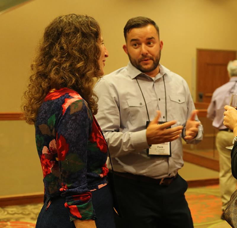 Zach Christensen discusses planned giving best practices with a client at the 2016 NCPP Conference.