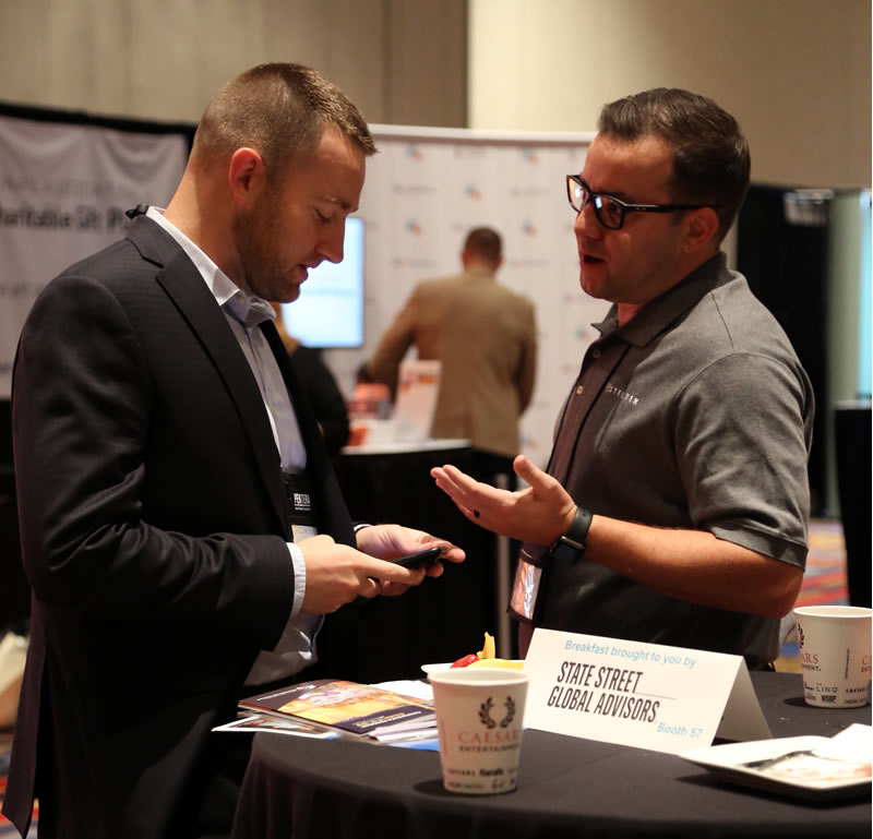 Zach Christensen discusses planned giving best practices with a client at the 2018 CGP Conference.