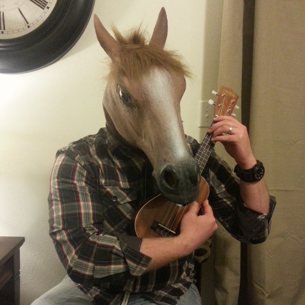 Justin wearing a horse head mask