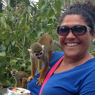 Wendi with a monkey on her shoulder