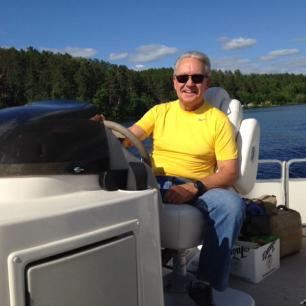Larry Stelter driving his boat