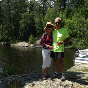 Peggy and Larry standing next to a lake